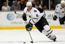 Mike Modano Dallas Stars Action with Iconic Jersey Flap